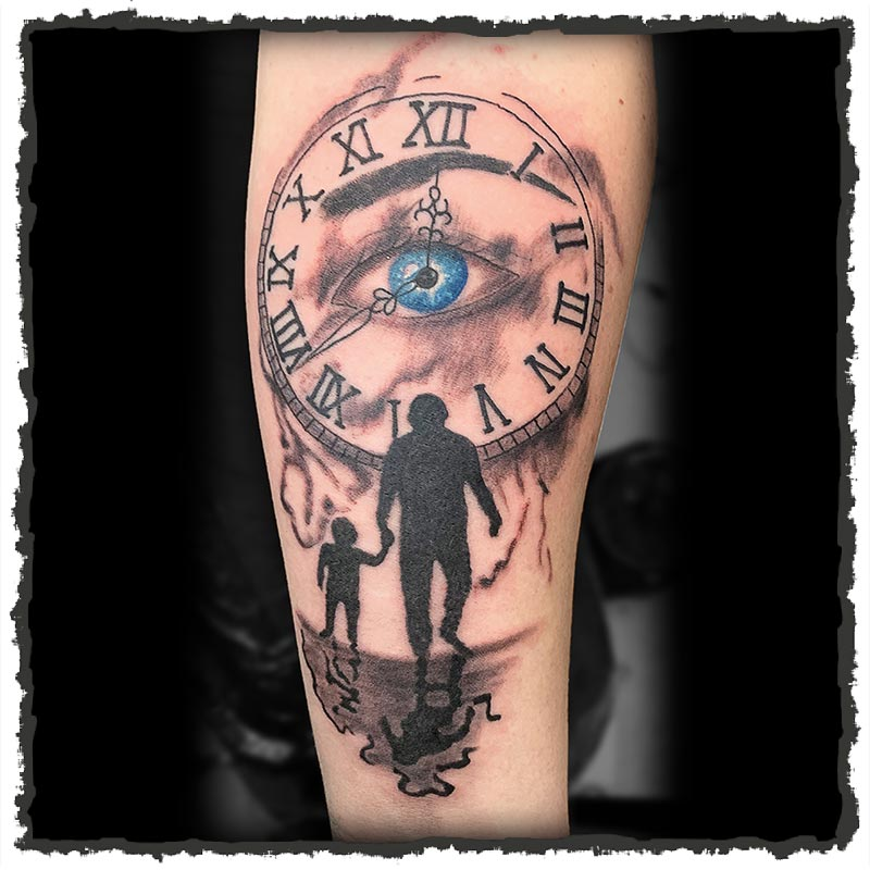 Tattoo by Lexx of A Clock with Father and Child