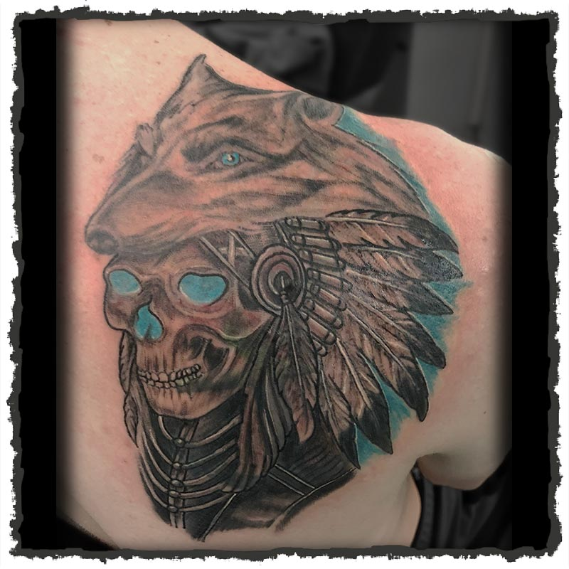 Tattoo by Lexx of a Skull with a Wolf Head-Dress