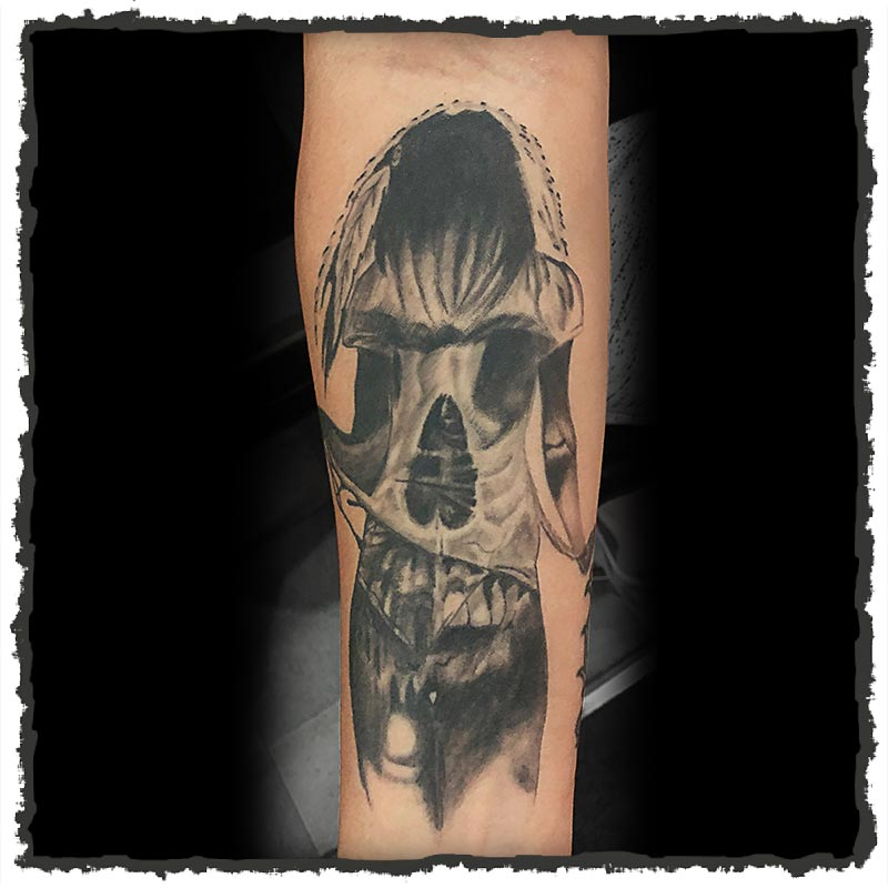 Tattoo by Lexx of a Skull Silhouette and Woman