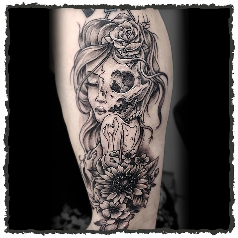 Tattoo by CJ of a Half Skull, Half Woman and Sunflower