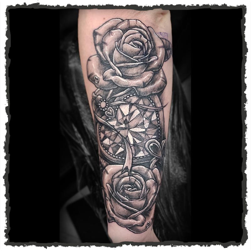 Tattoo by CJ of a Heart Gem surrounded by Roses
