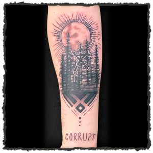 Tattoo by Jokey of a Forest and the word Corrupt