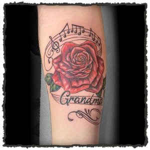 Tattoo by Maria of a Rose with Music Notes