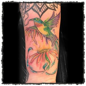 Tattoo by Lexx of a Watercolor Bird