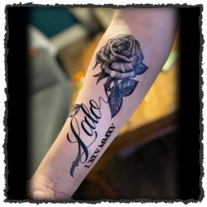 Tattoo by Frame of Script and Rose