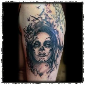 Tattoo by Jokey of a Woman wearing Day of the Dead makeup