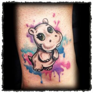 Tattoo by Jokey of a Baby Hippo with Watercolor
